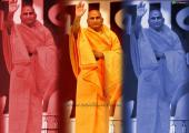 This is image of Avdheshanand Giri Maharaj,orange blue and pink color