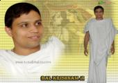 This is an image of Acharya Balkrishan ji , yellow and white color